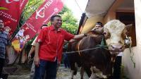Telkomsel  berikan bantuan 700 ekor hewan kurban