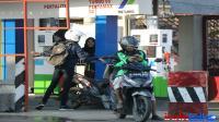 Grab vs Gojek, mana yang berjasa bagi ekonomi Indonesia?